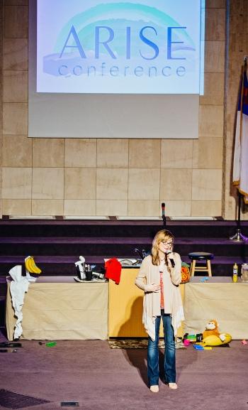 lara-talking-at-arise-conference